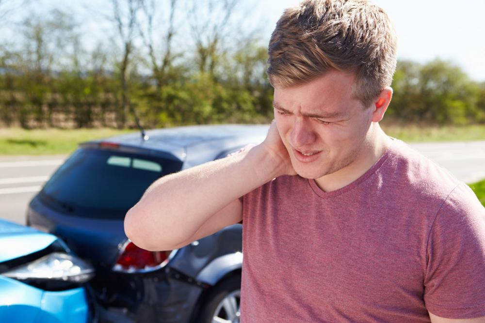 Man experiencing neck pain from a car crash